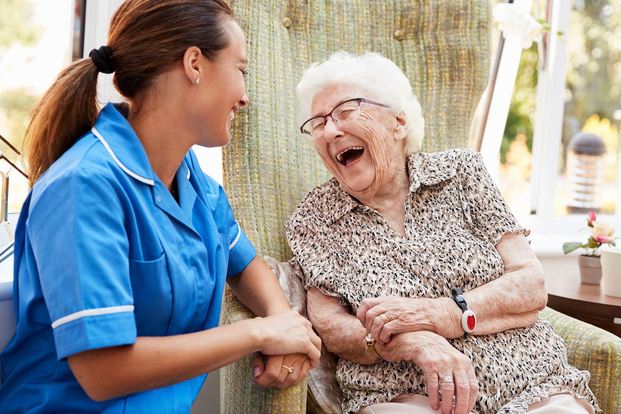 Senior Laughing With Nurse
