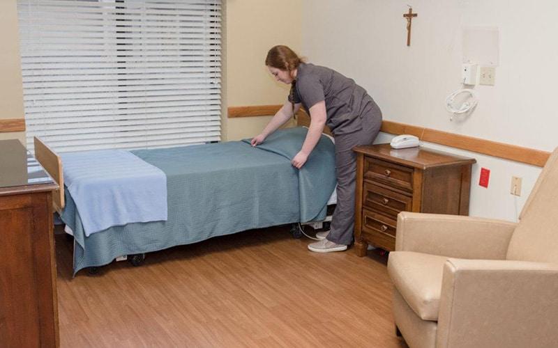 Nurse Making Bed