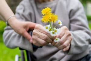 elderly-woman-flowers